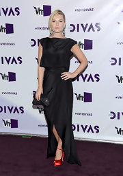 Elisha Cuthbert looked so elegant in this long black silk gown that allowed her red platforms to peek out.