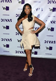 Brandy got funky on the VH1 purple carpet in this nude leather cutout dress.