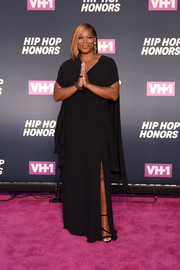 Queen Latifah polished off her glamorous look with strappy black heels.