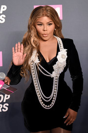 Lil Kim decked herself out in a statement-making layered pearl necklace by Chanel for the VH1 Hip Hop Honors.