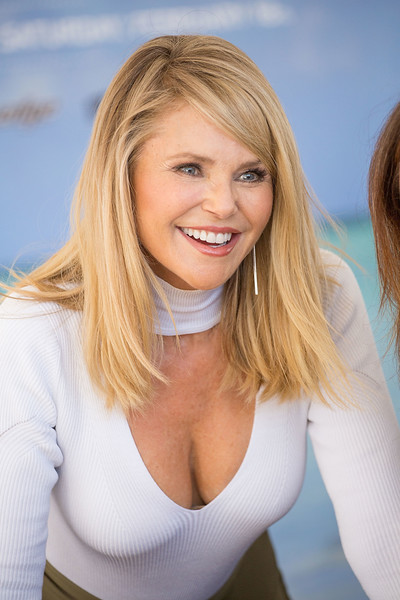 Christie Brinkley was stylishly coiffed with this straight side-parted style at the VIBES by Sports Illustrated Swimsuit 2017 launch.