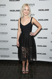 Jennifer Lawrence kept it chic all the way down to her Jimmy Choo buckle-detail sandals.