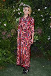 Amber Heard looked vibrant in a red print shirtdress by Valentino during the label's Couture Fall 2018 show.