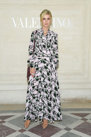 Nicky Hilton donned a printed maxi shirtdress by Valentino for the label's Couture Fall 2019 show.