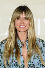 Heidi Klum was a boho cutie with her subtly wavy layers and parted bangs at the Valentino Couture Fall 2019 show.