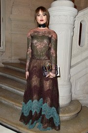 Kristina Bazan kept the colors coming with a beaded chain-strap bag, also by Valentino.