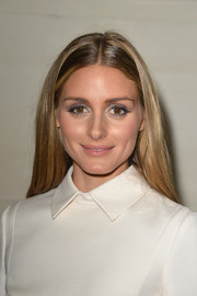Olivia Palermo opted for a loose, center-parted hairstyle when she attended the Valentino Couture fashion show.