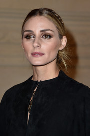 Olivia Palermo finished off her look with heavily gilded lids.