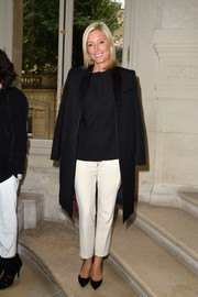 Princess Marie Chantal added some brightness to her look with a pair of ankle-length white slacks.