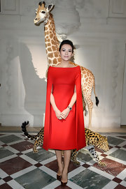 Zhang Ziyi showed off her sophisticated style with this sleek, red cape dress, which she wore to the Valentino Runway Show at Paris Fashion Week Haute Couture.