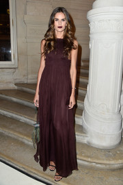 Izabel Goulart looked simply divine in a sleeveless burgundy empire gown by Valentino during the label's Couture fashion show.