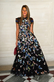 Anna dello Russo looked very princess-y in a butterfly-print gown with feathered cap sleeves during the label's fashion show.