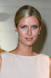 Nicky Hilton looked sleek and sophisticated at the Valentino runway show at Paris Fashion Week Haute Couture where she sported a slicked back 'do.