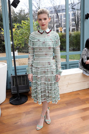 Kate Mara looked prim and proper in a tiered mint-green floral frock by Valentino while attending the label's fashion show.