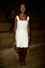 Shala Monroque chose a pair of camel-colored ankle-strap sandals to team with her dress.