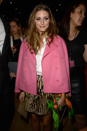Olivia Palermo looked stylishly retro in a pink swing jacket and an animal-print mini skirt at the Valentino fashion show.
