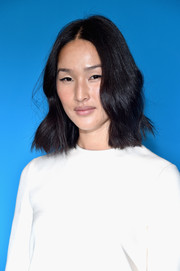 Nicole Warne looked cute with her center-parted waves at the Valentino fashion show.