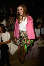 Olivia Palermo's green Va Va Voom bag provided a striking color contrast to her pink swing jacket at the Valentino fashion show.