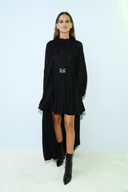 Izabel Goulart attended the Valentino Spring 2020 show wearing a little black dress and a matching cape.