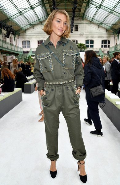 Arizona Muse was tough-glam in an embellished military-style jumpsuit by Valentino during the brand's Spring 2018 show.