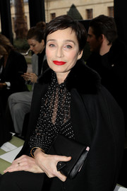 Kristin Scott Thomas accessorized with a classic black leather clutch at the Valentino Fall 2018 show.
