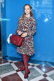 Teresa Palmer chose a pair of raspberry over-the-knee boots to finish off her look.