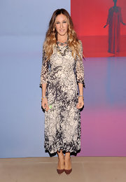 Sarah Jessica Parker added a touch of luxe to her ensemble with blush-colored satin stilettos.