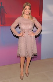 Angela Ismilos was chic in a chevron-embellished frock. She accessorized the look with glittering platform pumps.