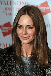 Trinny Woodall wore her hair in a simple yet chic center-parted style for the Valentino: Master of Couture exhibition.