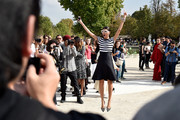 Giovanna Battaglia hammed it up for photographers at the Valentino show wearing a black-and-white striped T-shirt.