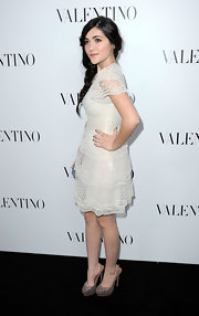 Isabelle Fuhrman attended the Valentino flagship store opening in Beverly Hills wearing a pair of studded lattice platform slingbacks.