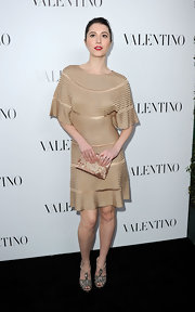 Mary Elizabeth Winstead carried this bronze embroidered clutch to the Valentino store opening.