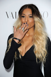 Ciara wore some delicately detailed navy blue nails featuring gold and crystal embellishments while attending the Valentino store opening in Beverly Hills.