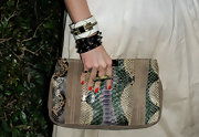 Louise Roe accessorized with this chunky bracelets at the Louise Roe carried this snakeskin clutch to the Valentino store opening on Rodeo Drive.