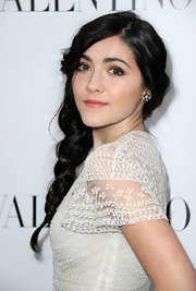 Isabelle Fuhrman arrived at the Valentino flagship store opening on Rodeo Drive wearing a pair of black and white diamond earrings.