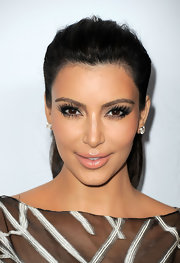 Kim Kardashian wore a pair of long feathery lashes to the opening of the Valentino flagship store opening on Rodeo Drive.