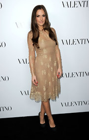 Minka Kelly looked regal in this nude lace dress with flecks of gold at the Valentino store launch.
