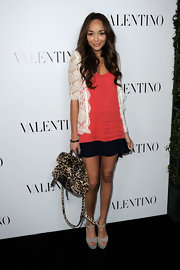 Ashley Madekwe paired this lace cardigan with a coral blouse for the Valentino store opening on Rodeo Drive.