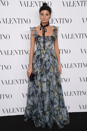 Giovanna Battaglia charmed in a gray Valentino print gown during the brand's Sala Bianca 945 event.