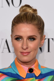 Nicky Hilton pulled her hair up into a cute top knot for the Valentino Sala Bianca 945 event.