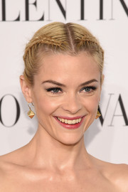 Jaime King attended the Valentino Sala Bianca event wearing a charming center-parted double braid.