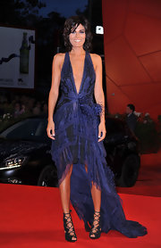 Valeria Solario showed off her stunning figure in a navy blue evening dress with a plunging neckline.