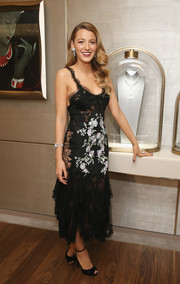 Blake Lively attended the Van Cleef & Arpels cocktail party looking sultry and glam in a black-and-white lace dress by Marchesa.