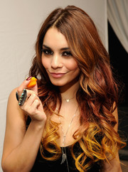 Vanessa Hudgens sported fun-looking ombre curls when she attended the Donate with a Kiss event.