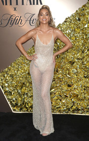 Jasmine Sanders turned up the heat in a sheer silver slip gown at the Vanity Fair 2019 Best Dressed List event.