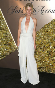 Nicky Hilton Rothschild looked effortlessly chic in a plunging white halter jumpsuit by Misha Nonoo at the Vanity Fair 2019 Best Dressed List event.