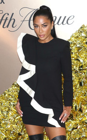 Nicole Scherzinger donned a black-and-white Givenchy mini dress with padded shoulders and diagonal ruffle detailing for the Vanity Fair 2019 Best Dressed List event.