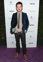 Elijah Wood arrived at the 'Vanity Fair' event looking like a true gentleman wearing a suede blazer.