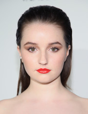 Kaitlyn Dever went for a bold red lip color.