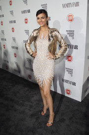 Victoria Justice glimmered in a gold moto jacket layered over a cocktail dress during the Fiat Young Hollywood celebration.